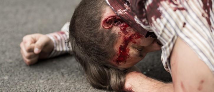 terroist attack man bleeding