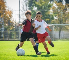 shutterstock_172398914 2 boys playing football