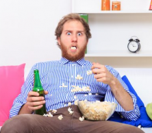 man eating popcorn